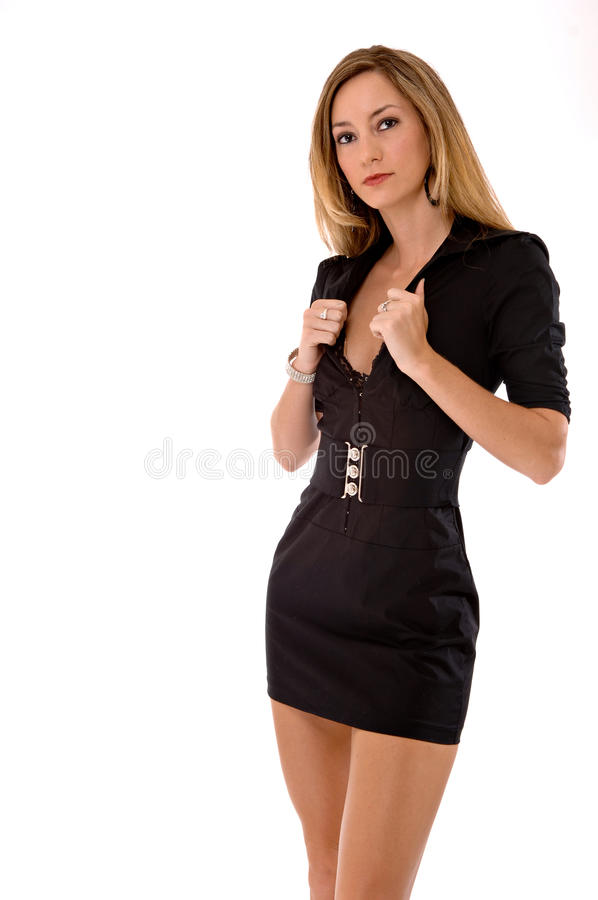 Blond beauty in a short black dress royalty free stock photos