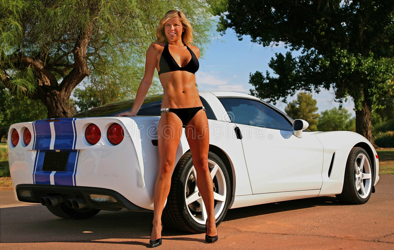 Blond bikini Babe with Corvette royalty free stock images