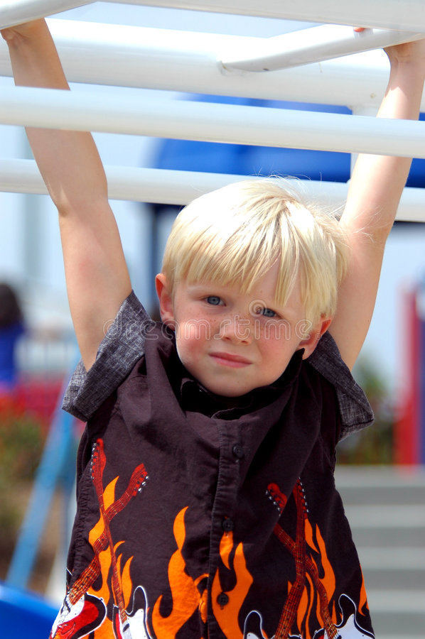 Blond Boy Child On Bars royalty free stock photography