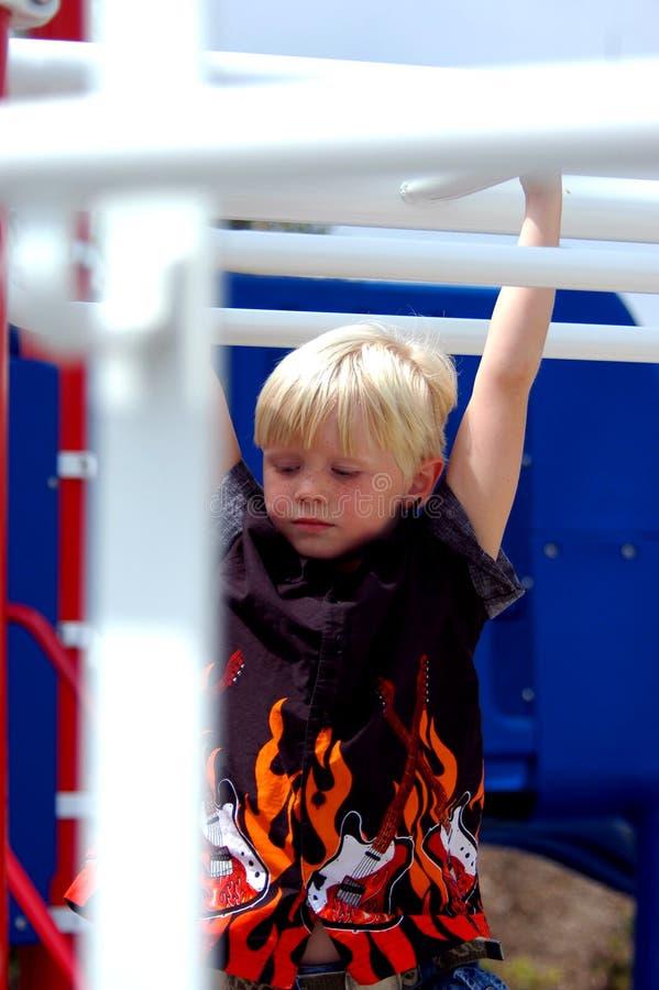 Blond Boy Child On Bars royalty free stock photos
