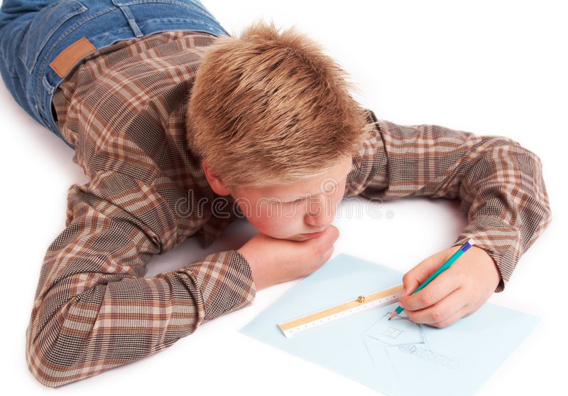 Blond boy drawing a picture royalty free stock photography