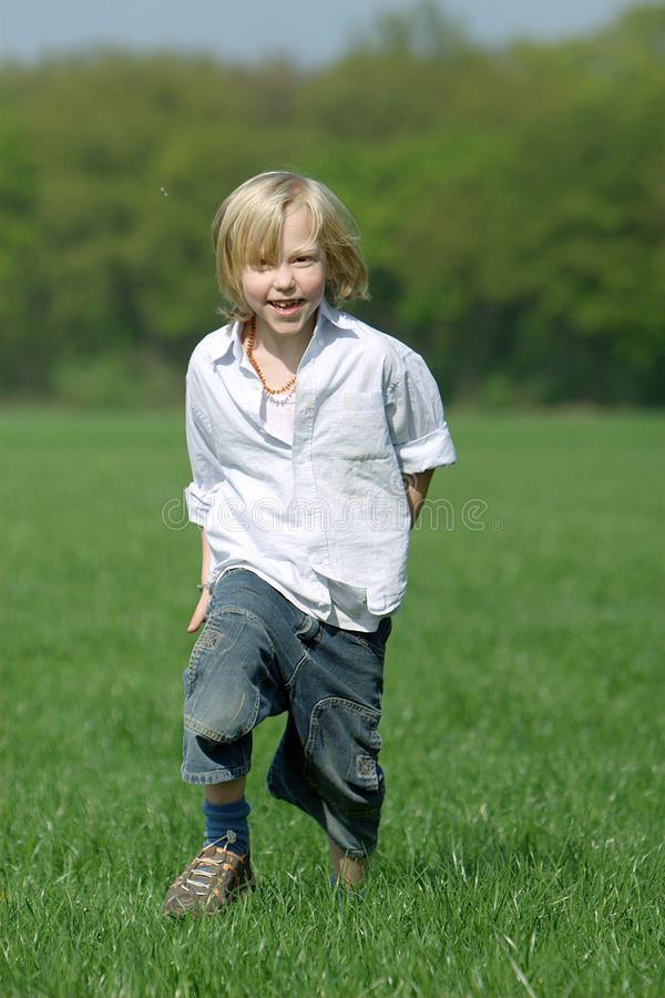 Download Blond Boy Laughing And Running Stock Photo - Image: 10190776