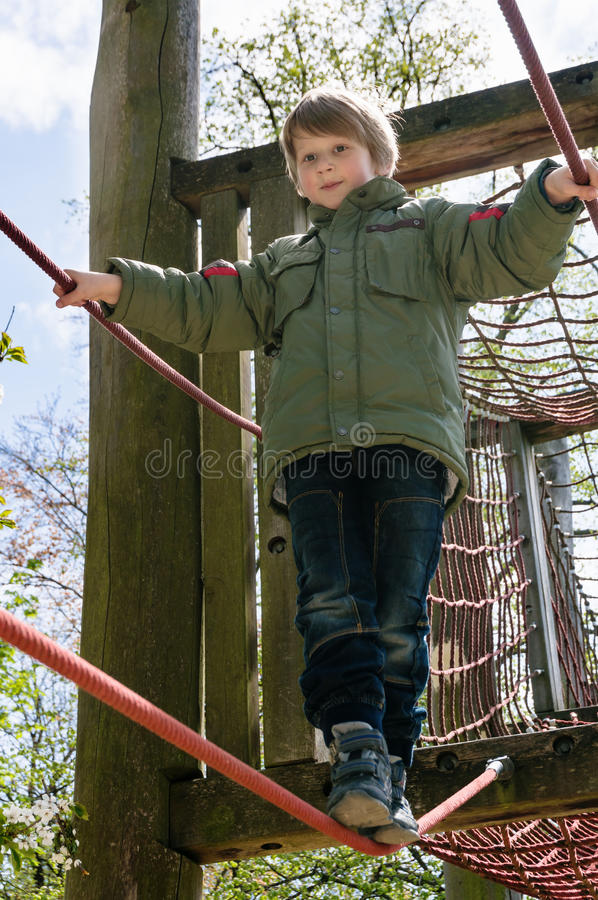 Download Blond boy at playground stock photo. Image of flowers - 30919026