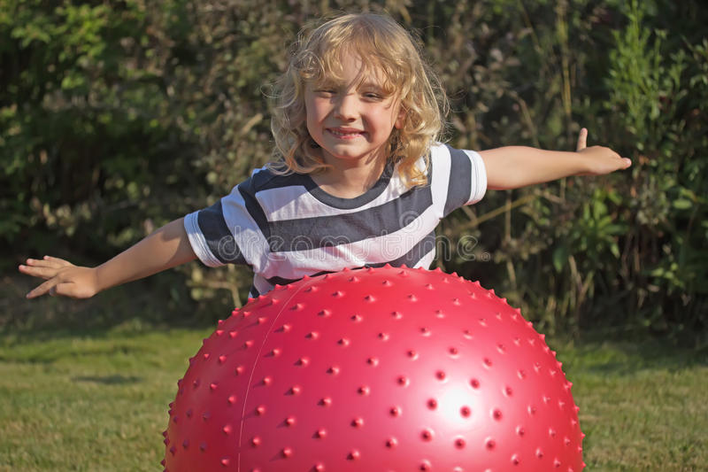 Download Blond Boy Is Playing With Gymnastic Ball Stock Photo - Image: 32488392