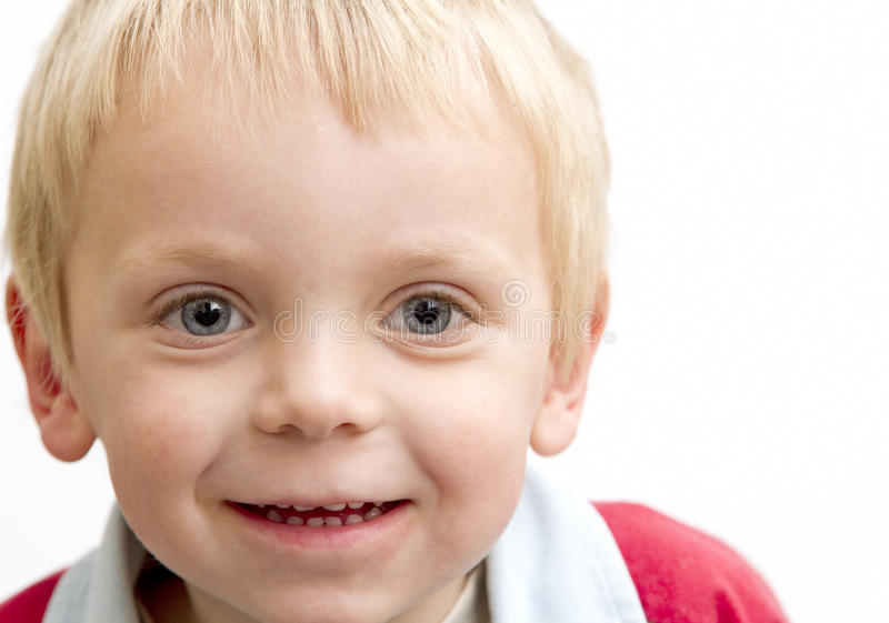 Blond boy smiling royalty free stock images