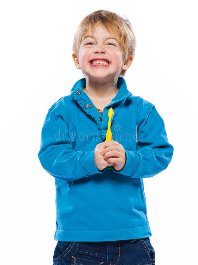 Blond boy with a toothbrush stock photos