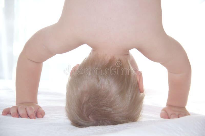 Blond boy is upside down