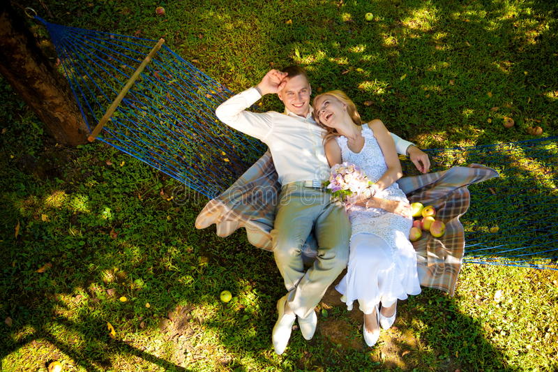 Blond bride and groom in nature. Beautiful and happy bride and groom in nature royalty free stock images