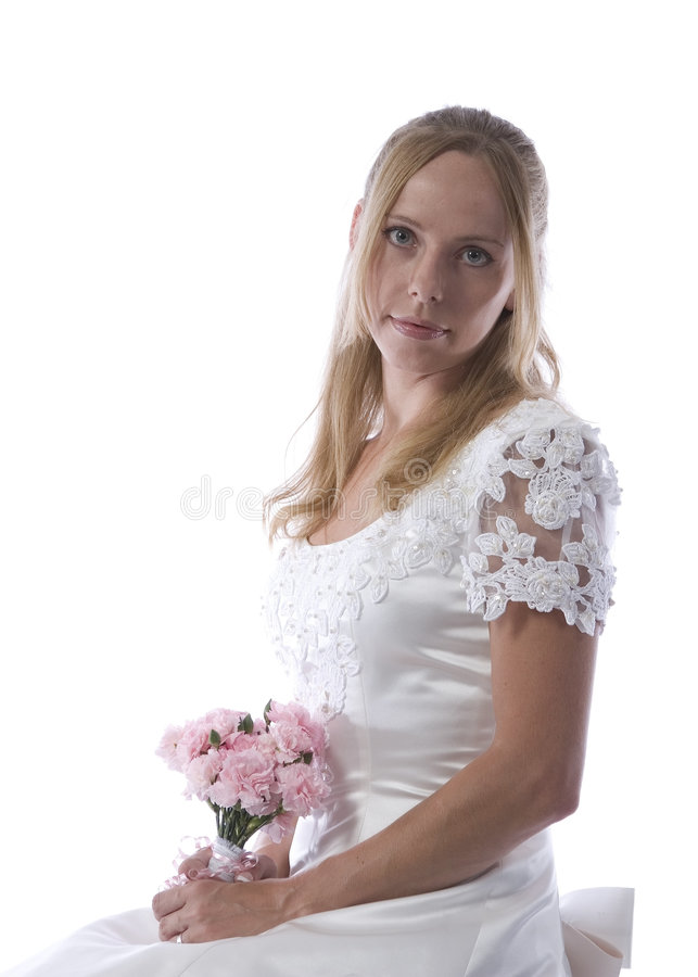 Blond bride in wedding dress. Attractive young bride in wedding dress with bouquet of flowers; isolated on white background stock photo