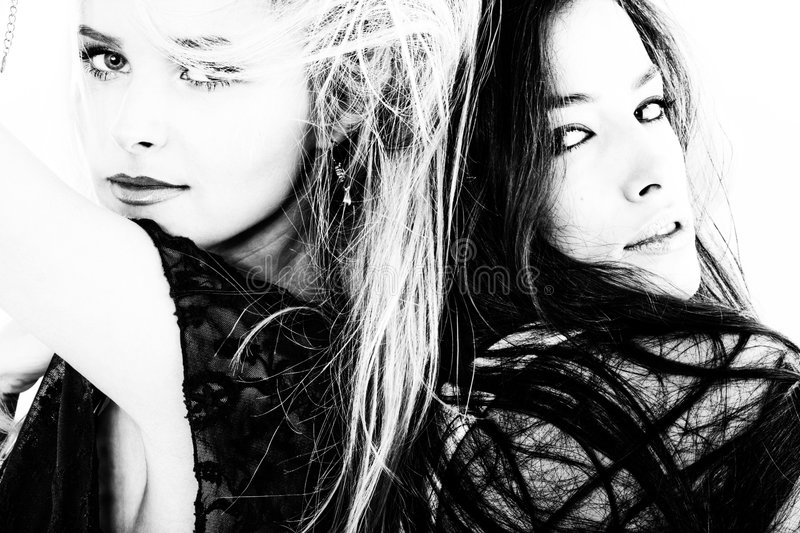 Blond and brunette portrait in black and white royalty free stock photography