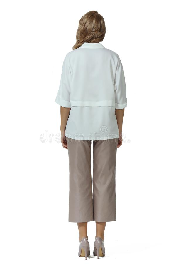 Blond business woman with long hair in formal white short sleeve official blouse kulottes beige trousers high heels stiletto shoes stock photos