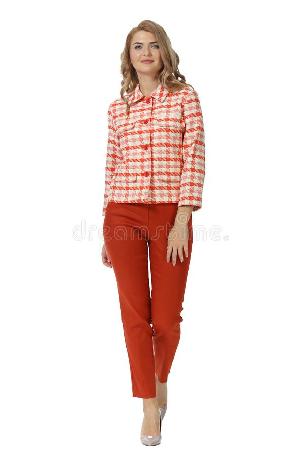 Blond business woman with long hair in summe rcasual red checkered jacket trousers high heels stiletto shoes full body photo royalty free stock photography