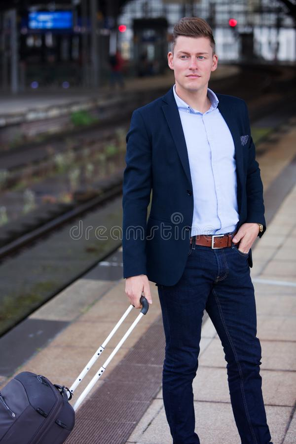 Blond businessman waiting for the train stock photo