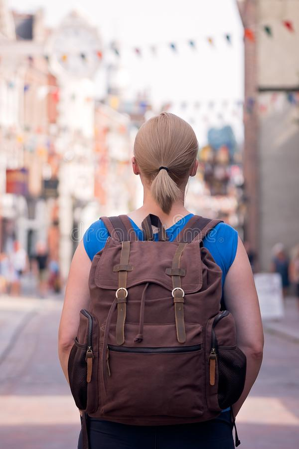 Casual female traveler with a backpack stock photo