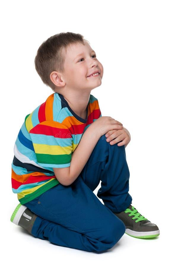 Blond chłopiec w pasiastej koszula obrazy stock