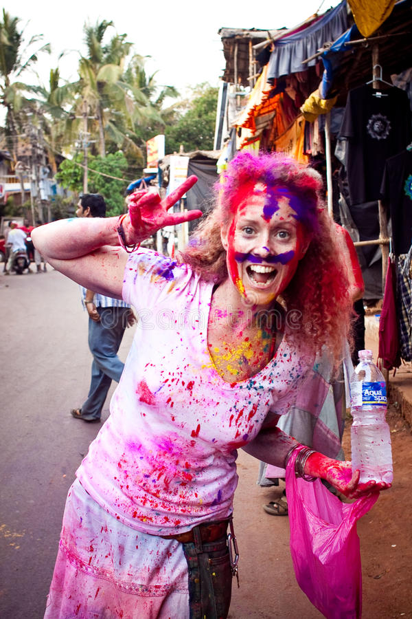 A Blond with colors on her face in india stock image