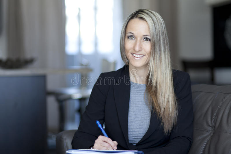 Blond Confident Businesswoman Working At Home stock images