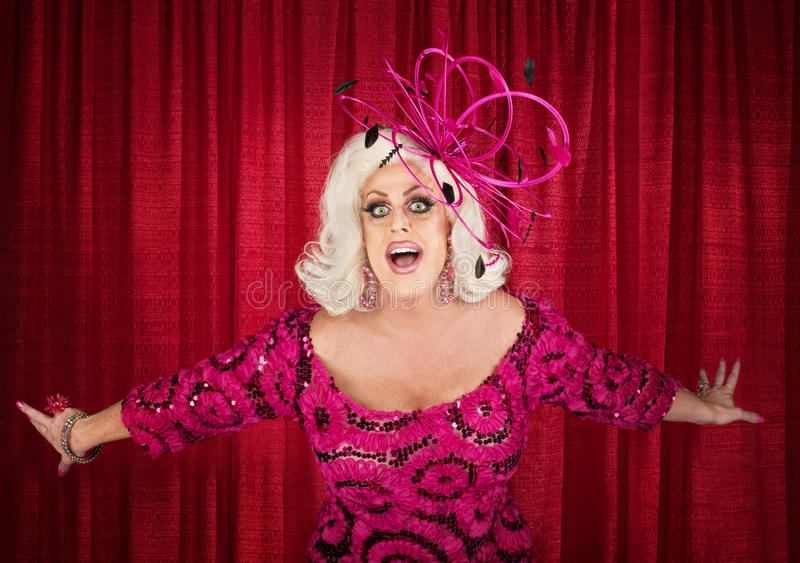 Blond Drag Queen Singing. Happy drag queen in blond with singing in theater stock images