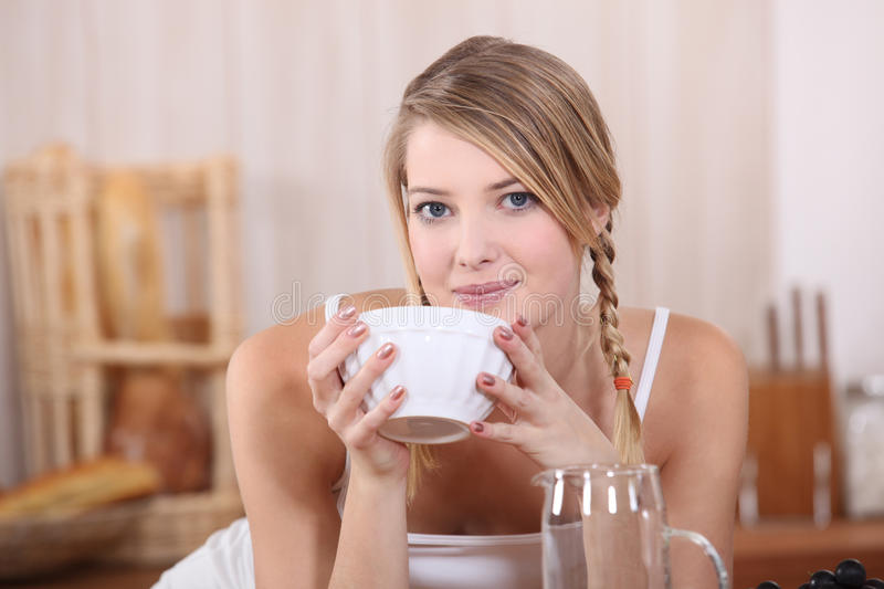 Blond Drinking From Bowl Royalty Free Stock Image