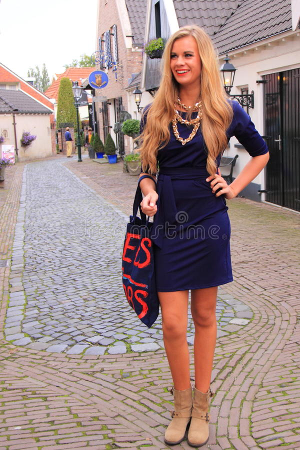 Blond dutch woman street fashion royalty free stock photography