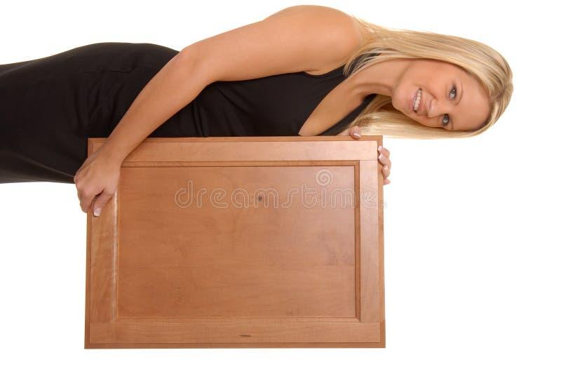 blond dziewczyna trzyma sexy znaku fotografia stock