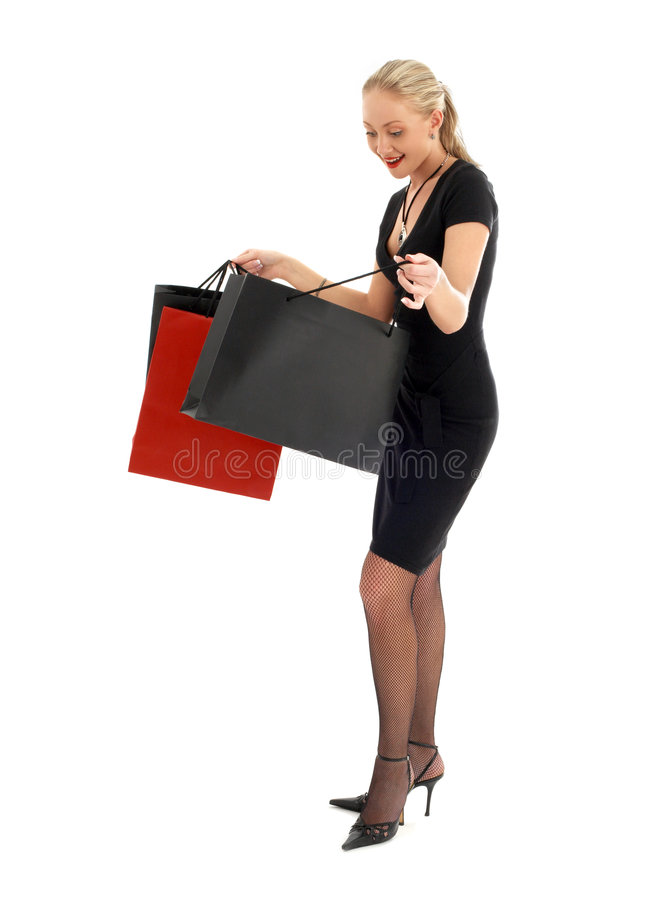 blond euphoric shopping arkivbild