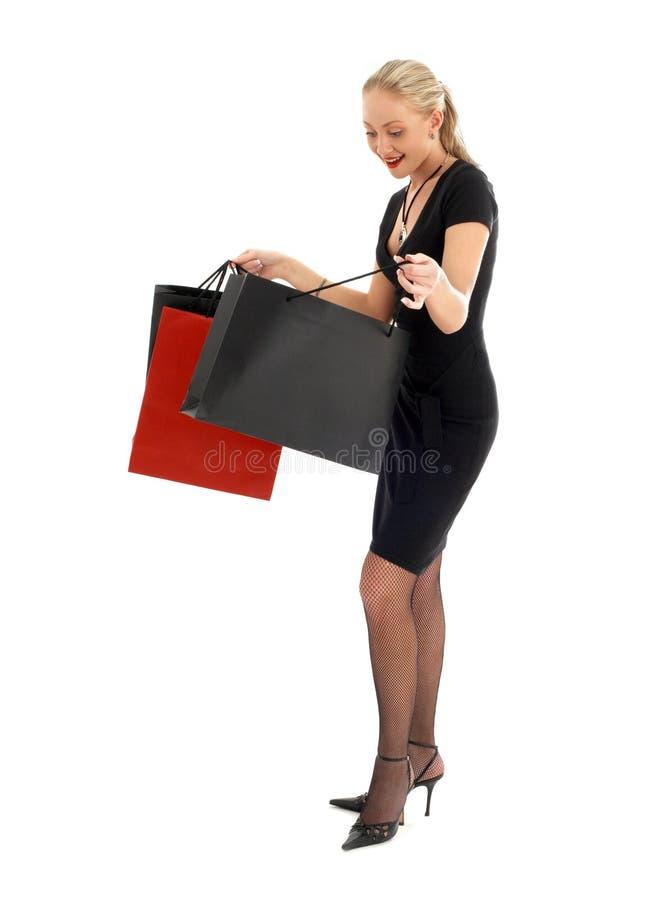 blond euphoric shopping royaltyfria bilder