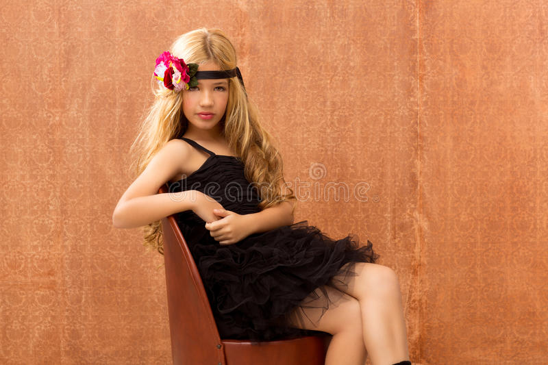 Blond fashin kid girl on retro vintage seat royalty free stock photos