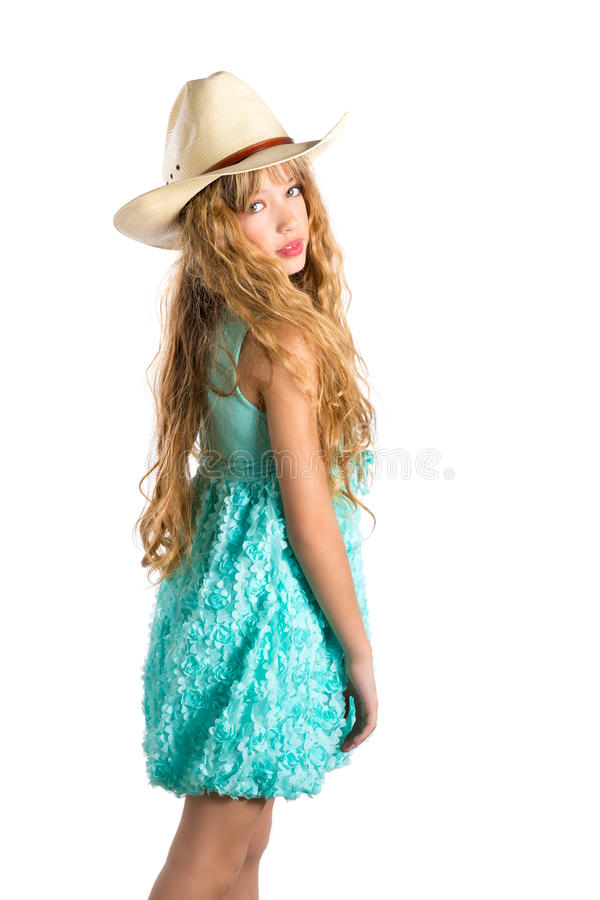 Blond fashion cowboy hat girl with turquoise dress stock photography