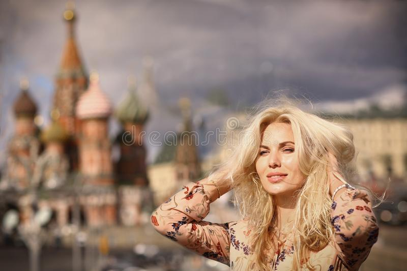 Blond fashion model russian girl close up photo on red square ba royalty free stock photography