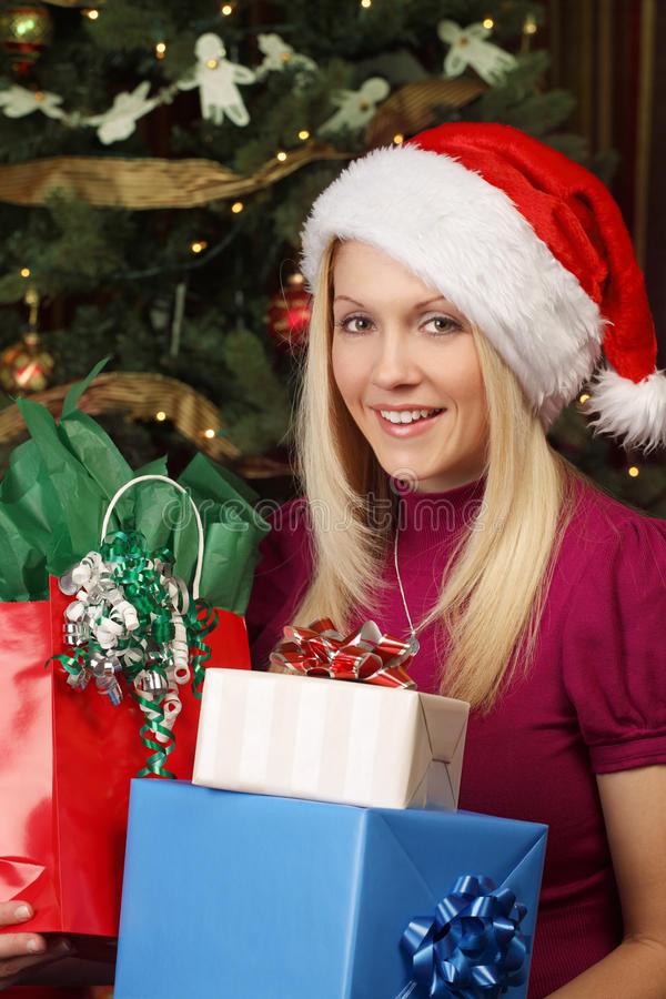 Download Blond Female Holding Christmas Presents Stock Image - Image of tree, person: 17414835