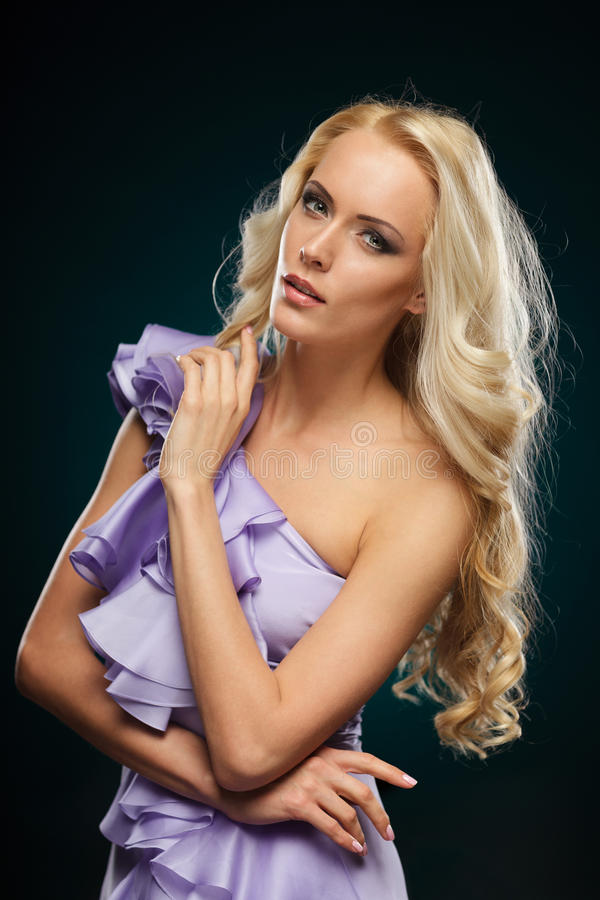 Blond female in purple dress royalty free stock photos