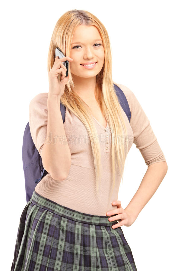 Download A Blond Female Student With A School Bag Talking On A Phone Stock Photo - Image: 28391944