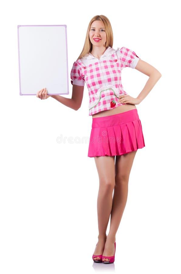 Blond flicka i rosa färger med affischen som isoleras på vit arkivfoto