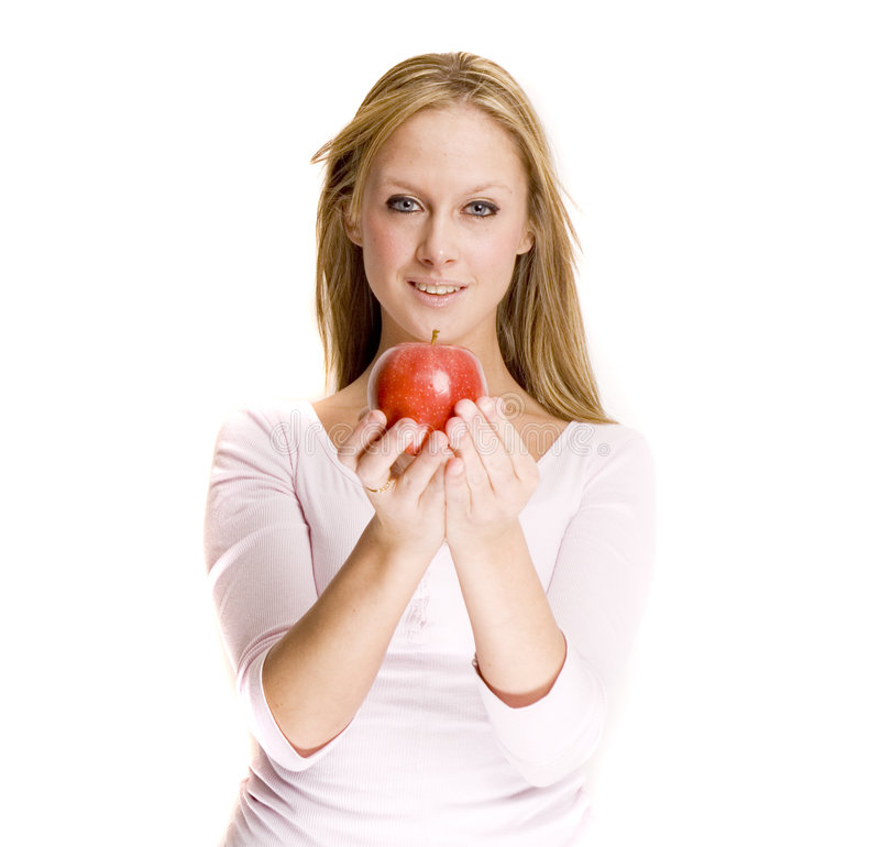 Blond girl and apple royalty free stock photos