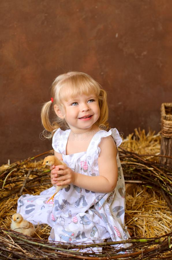 blond girl with chickens royalty free stock photos