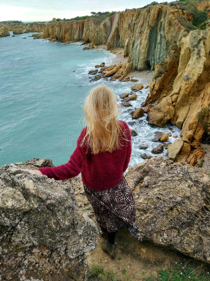 Blond girl on the cliffs stock photo