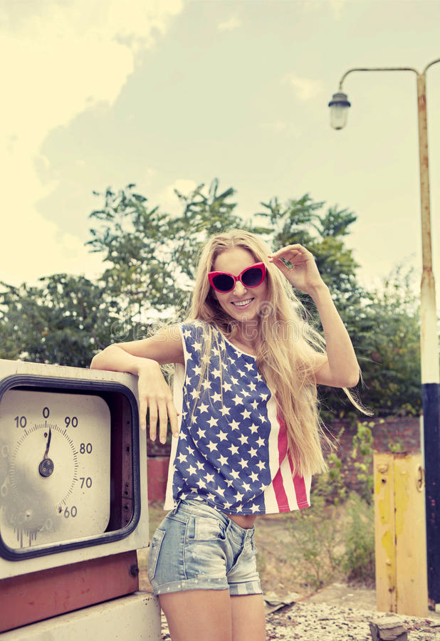 Download Blond Girl On Damaged Gas Station Royalty Free Stock Images - Image: 27078719