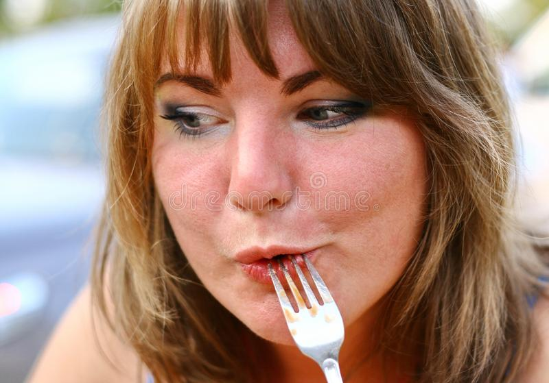 Blond Girl Eating royalty free stock photo