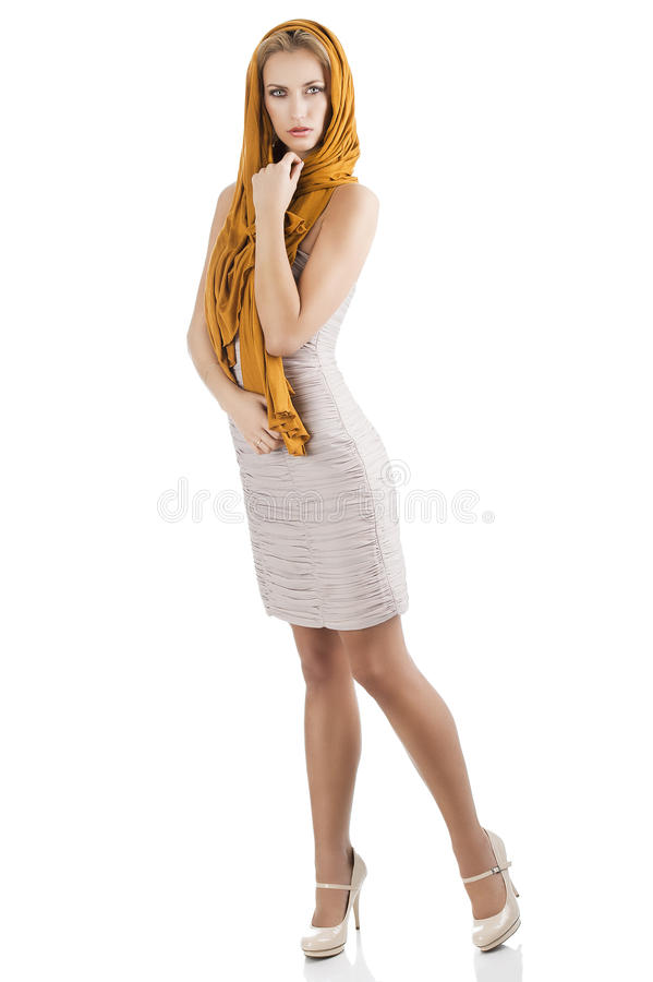 Blond girl in elegant dress, she is turned of thre