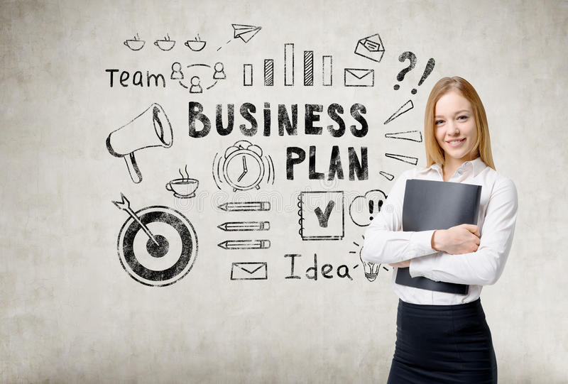 Blond girl with folder and business plan icons. Smiling blond woman holding a black folder is standing near a concrete wall with business plan sketch on it stock photography
