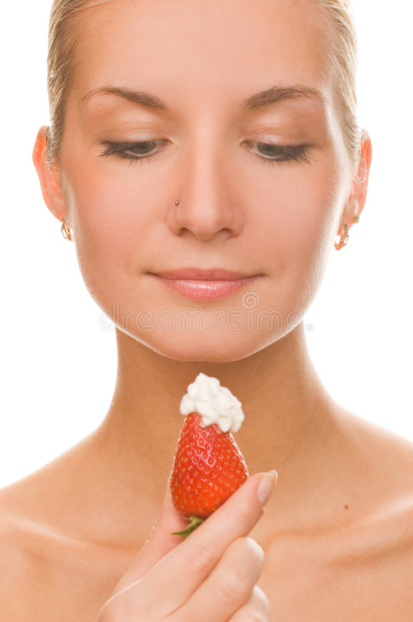 Blond girl with a fresh jucy strawberry stock photo