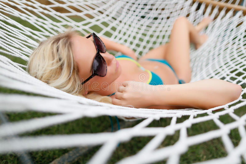 Blond girl in hammock royalty free stock photos