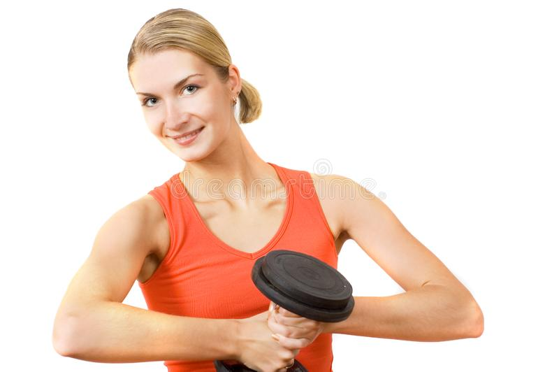 Blond girl with heavy dumbbell royalty free stock photo