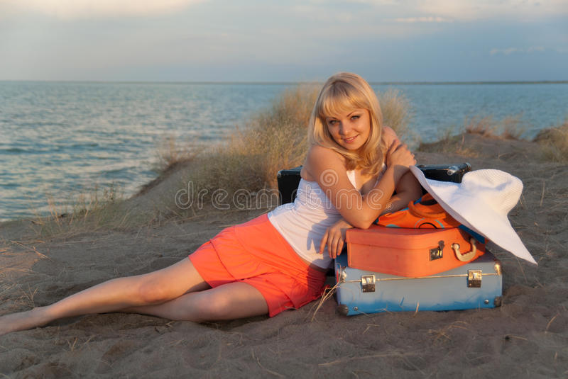 Download Blond Girl With Her Luggage On The Beach Stock Image - Image: 21755811