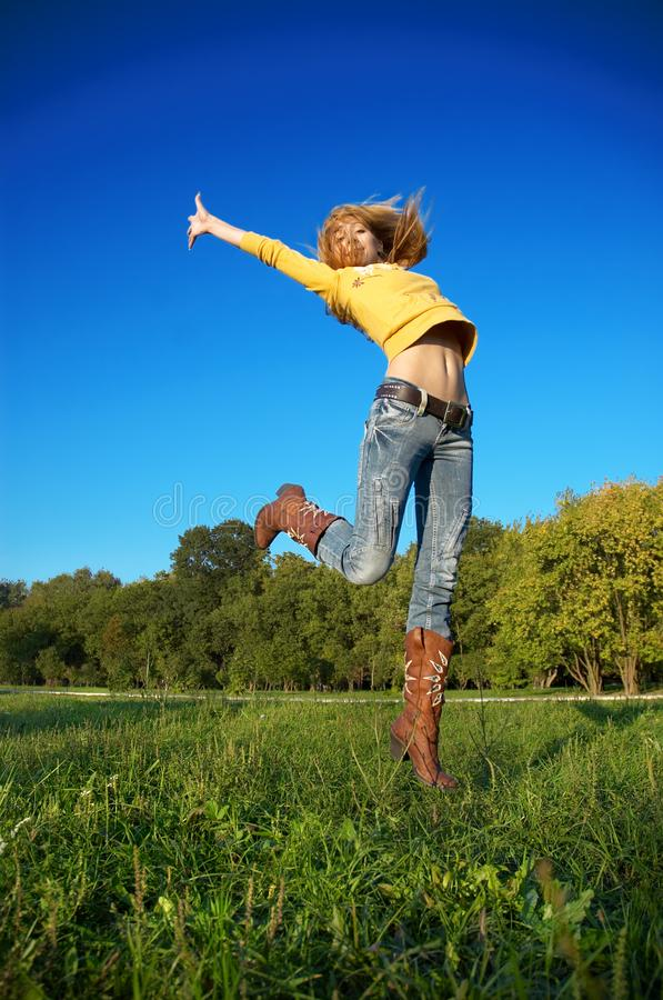 Download Blond girl jumping stock image. Image of happiness, beauty - 3292801