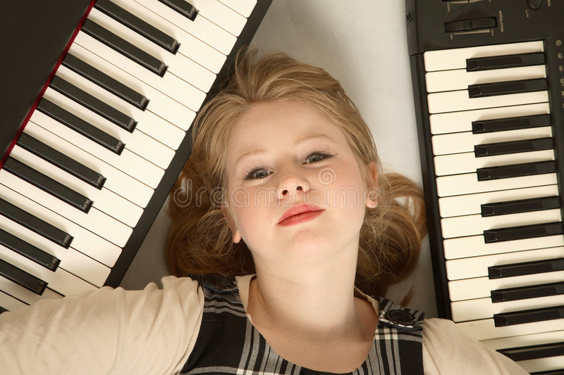 Blond Girl And Keyboards Stock Photo