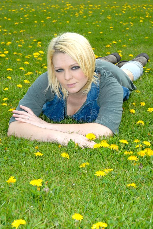 Blond girl lay in field stock image. Image of female ...