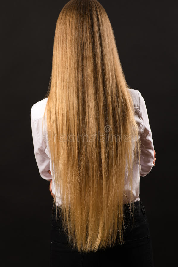 blond girl with long beautiful hair back view stock image
