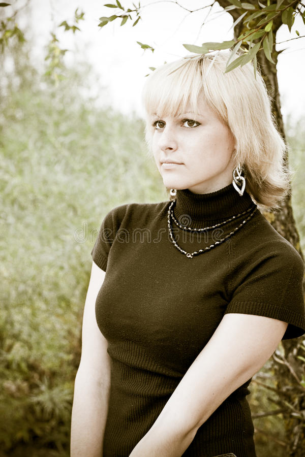 A blond girl looks in distance royalty free stock photo